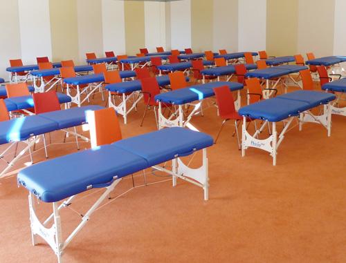 Clap Tzu Kofferliegen in einem Schulungsraum
