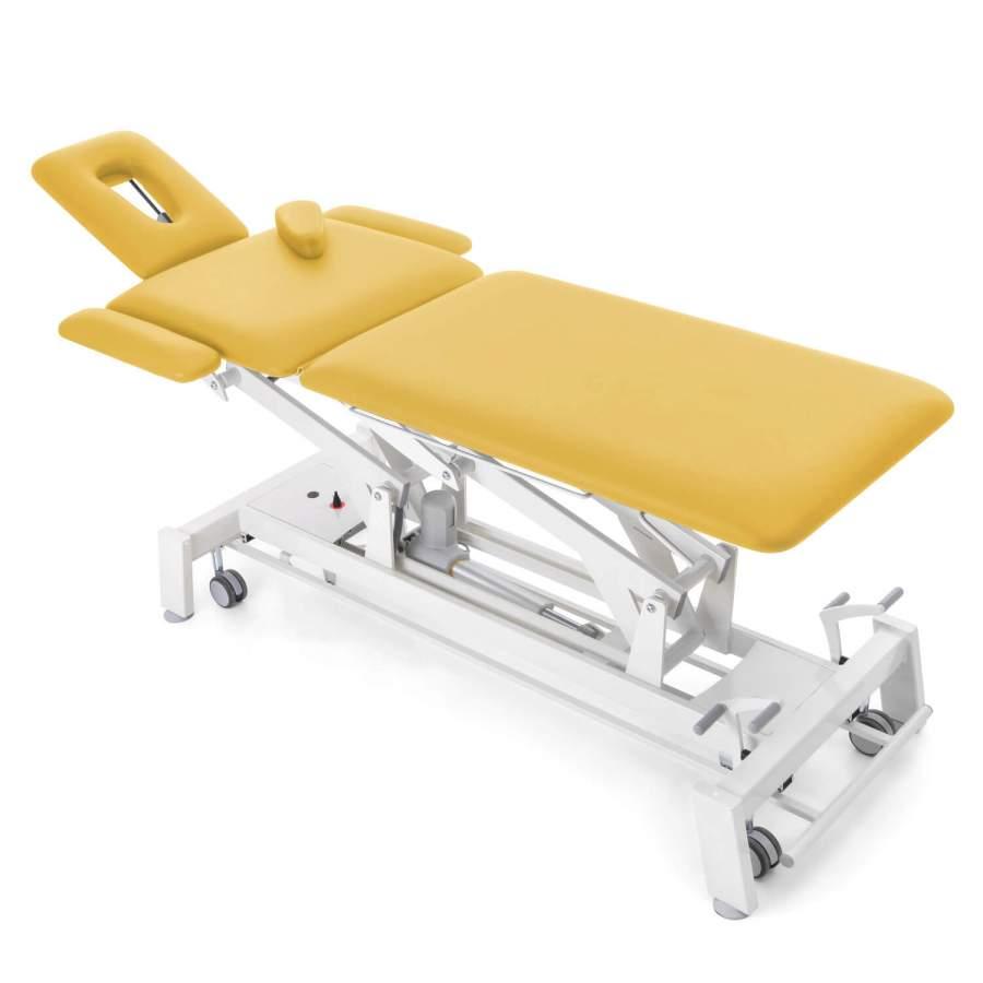 Osteopathieliege STOCKHOLM Osteo: elektrisch höhenverstellbar, extra schmal, seitliche Verbreiterungen - Im Bild: optionaler Radhebesatz - Bezugsfarbe: honig-gelb